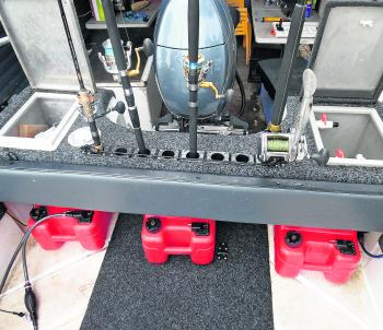 Under the rear deck is a great place to store portable fuel tanks, as this will help to balance out the weight.
