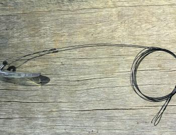Some hardbody lures do not swim from the packet or can be belted up and require tuning. A length of single strand wire with each end containing a haywire twist will keep them from pulling out of the water.