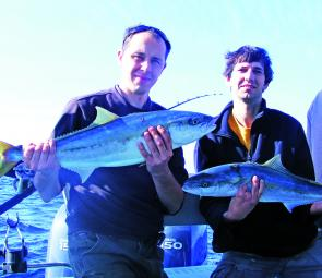 Joseph, left, and workmate Martinwith their first kingfish.