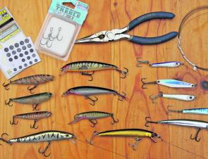 An arsenal of tailor tackle. Small metal baitfish imitations, shallow divers, topwater varieties, mono wire (in this case nickel-titanium Knot2Kinky), and stick-on lead spots for balancing cheaper lures.