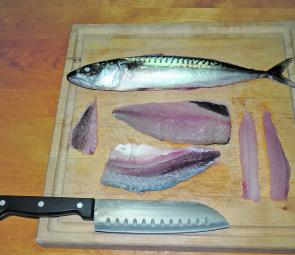 Two mackerel strips (one from the upper section of the fillet and the other from the lower section of the fillet) on the right ready for cooking. Note that the rib 'flaps' make good bream baits and the flesh and skin left overs make good berley.