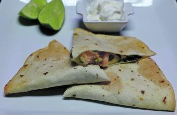 Remove the tray of quesadillas from the oven and allow to cool on a wire rack. Slice each quesadilla into wedges and serve with either guacamole or sour cream.