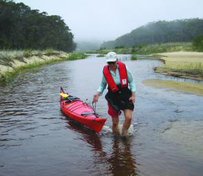 The lower reaches of the Thurra River are shallow and kayaks need to be dragged upstream.