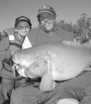 Young Jock Mackenzie admires a very nice cod taken in the Murray by his Dad on a white Bassman spinnerbait. Will the fresh flow from Queensland help revive the Murray? Only time will tell.