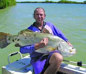 The author with a reasonable PB barra of 128cm. Now that is a fish worth visiting Karumba for!