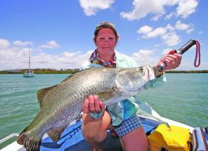 Christine Finney with a 65cm barra taken on a soft plastic.