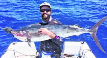 Christian with a black marlin caught on the 24 fathom east of the Seaway.