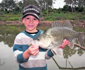 Even kids can handle light line. The author's son Blaise had a light drag setting but still managed to keep this big bass away from the hidden snags.