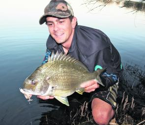 This bream ran the 4lb through some spindly sticks, and after backing off the drag the author was forced into the water to untangle it.