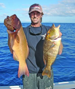Sharkey holding a couple of our favourite reef fish from a recent trip: coral trout and red throat emperor.