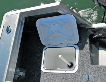 A plumbed live bait well is one of the Catcher's handy features.