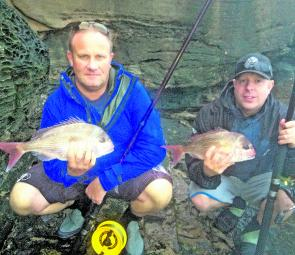 Daniel Dekelle and John Halford (from left) with a pair of decent snapper taken from the wash.