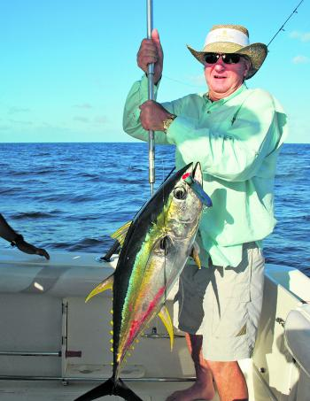 This chunky yellowfin tuna took a popper cast over the reef.