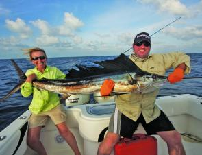 The author, Kim, and her dad, Steve, with a sailfish caught on the drinking straw live garfish rig.