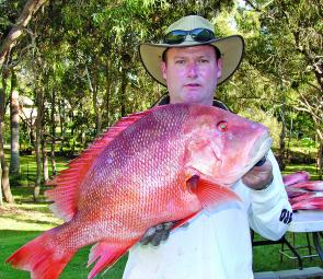 Graham Harriman with a red emperor – the reefs have been fishing well thanks to the reprieve from recent bad weather.