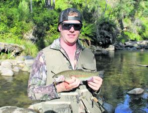 David Ryder with a nice rainbow trout caught in a tributary of the Kiewa River on a gold Super Vibrax bladed spinner.