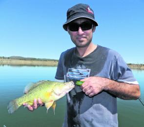 Aaron Rawiri of Tamworth showing the spoils of trolling a deep diving lure at Lake Keepit.