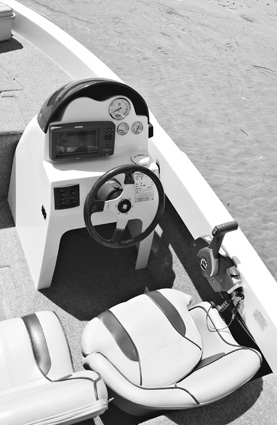The helm is functional and comfortable, but there's a rare abundance of space to flush-mount your electronics.
