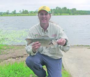 Paul Fleming with what has become a good Lake Macdonald bass.