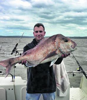 Terry Phillips displays a cracking snapper taken on a squid bait.