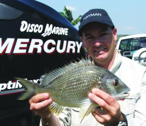 Jason Disson with a bream showing a recent scar from the red spot disease outbreak.