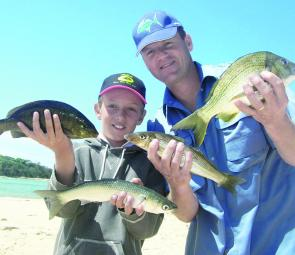 Young Brock Bismire with TV host Rob Paxavanous. They spent an afternoon catching a variety of species from a local estuary.