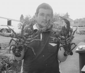 Russell Macklin holds up two thumping freshwater crayfish that a mate and he caught locally. These fish went well over the 12cm carapace length, which filled each of their bag limits of one crayfish each over 12cm carapace length.