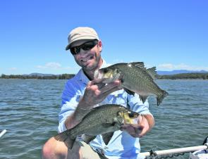 Doug with a pair of 36cm estuary perch from Tuross about to be released.