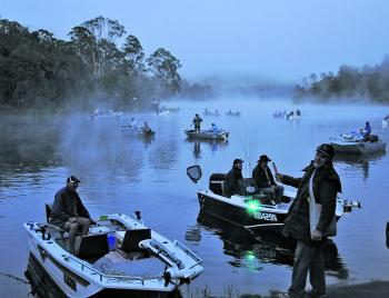 Anglers of the bass competition waiting for the start flare