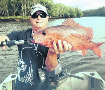 Craig Mullet with a nice jack from the upper reaches of the Maroochy.