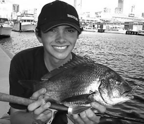 St Kilda local Jordan Trusty with one of many bream he's been catching in and around the Docklands area on lures.