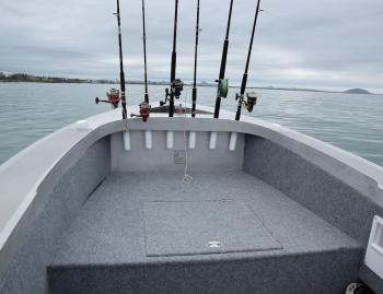 Pat values his cockpit space and has set his rod holders up the bow and out of his way. Other anglers will prefer alternative storage options. Most are possible in a plate alloy boat.
