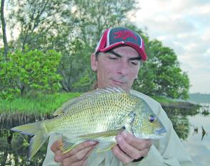 The author with a good bream taken in the lake shallows. As we move into the cooler months, fish like this may respond best to metal blades or scented soft plastics.