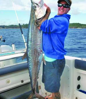 This 25kg Spanish mackerel made this angler happy when it smashed a bait at Point Lookout.