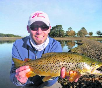 Tom Kulczynski with a Newlyn Reservoir brown trout - caught casting Frog Pattern Tassie Devil lures and also bait fishing with a mud eye.