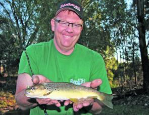 "Wayne ""Strawba"" Gardner with a lovely brown trout that fell to a JD 5cm minnow late in the season. Strawbs might have out-fished me that day (might have) and that's why he is wearing that great big cheeky grin!"