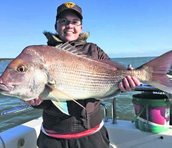 'Think Big' client Ashleigh was fortunate enough to land a magnificent 6.2kg snapper for herself. (Photo supplied by Think Big Charters).