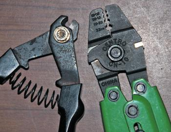 The tool on the right is a swaging tool (often called a crimping tool). They have a size guide as to which crimps are best used in which part of the jaws. Swaging tools constrict the crimp around the wire, mono or fluoro while keeping it very low profile