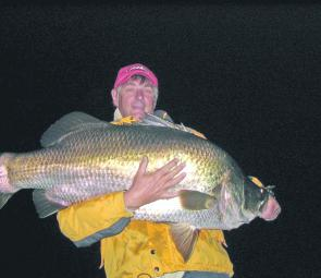 Big barra come out to play in winter. Trevor burgess struggles to hold up a 117cm beast!