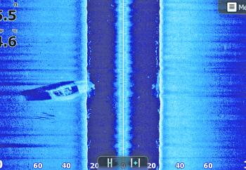 A typical Side Scan image showing the left and right hand side of our boat. In this image we can see a boat wreck on the left hand side.