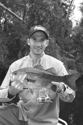 Brendan Kiely was all smiles with this lovely 48cm wild river bass, caught on an Ecogear SX40.
