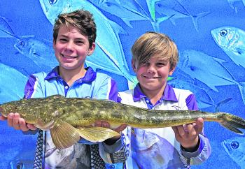 Will Bradford and Riley Schellaars from Noosaville caught their 65cm flathead around Crab Island near the top of the Frying Pan.