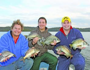 Mick, Steph and Ace with a brace of bream, part of 95 fish caught for the day and all released.
