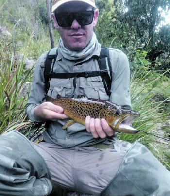 James Perry with a healthy brown trout caught on a Rapala X-Rap.