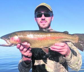 Irish tourist Mark Sloan with a beaut Toolondo rainbow to go with his two nice browns, and several redfin he landed on a great day out.