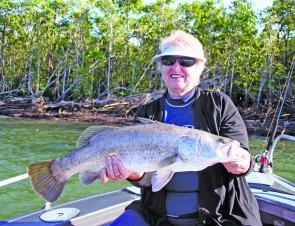Jan Pitmuss from the Central Coast of NSW with a nice river mouth barra taken recently on Blackout Sportfishing.