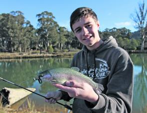 "Kane Nicholson with a nice rainbow trout caught in Stanley Ditch Dam on a Strike Tiger 1"" soft plastic nymph."