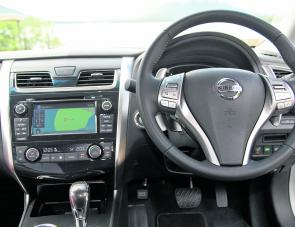 A look at the Altima's dash layout: there's a neat blend of tonings with all controls easily identified.