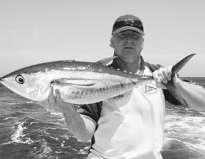 Peter Sharland with a tagged yellowfin about to be released during the Huskisson White Sands Tournament.