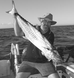 The author with a mackerel caught locally out from Brisbane.